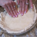 putting the pie crust in the pan