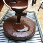 pouring the ganache on the cake